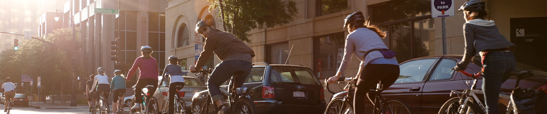 Bike riders riding down the street