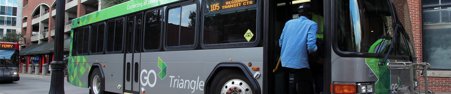 Man boards GoTriangle bus parked in Moore Square